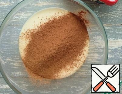 In a separate container, transfer half of the resulting mass (this is about 450 g.). In one half, add the cocoa powder.