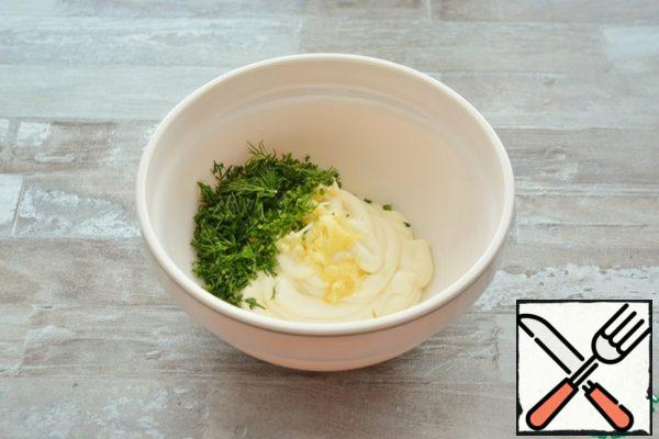 For the layer, combine mayonnaise with crushed garlic and dill