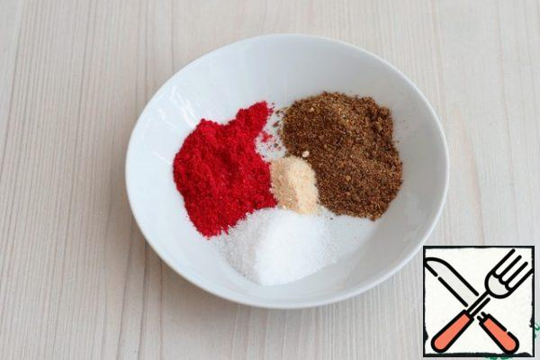 Prepare the spices for marinating the meat. In a bowl, add salt (to taste), add sweet paprika, add the prepared mixture for frying meat, which includes: coriander, onion, nutmeg, paprika, black pepper, cumin, marjoram, garlic, red pepper, basil, savory.