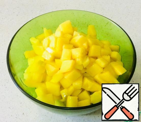 Cut the mango into small cubes, approximately 1cm x 1cm
