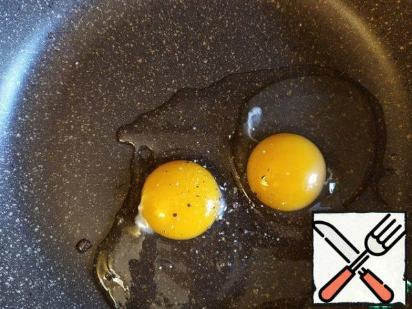Break the eggs into a large, flat dish (where the breast will fit). Season with salt, pepper, and mix.