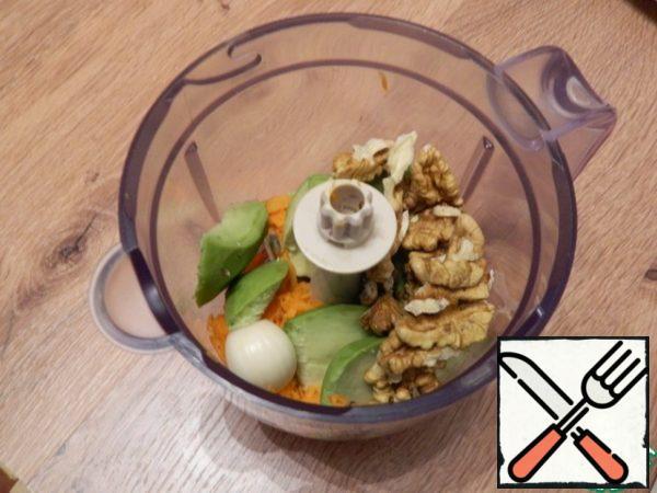 Add a clove of garlic, nuts, and a pinch of ground coriander.
