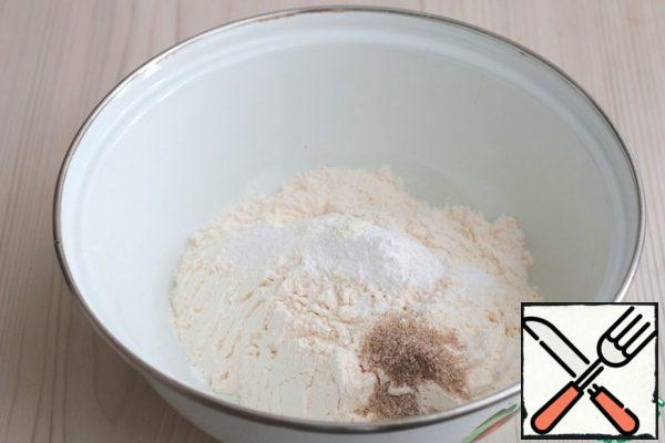 In a bowl, add the dry ingredients: Flour (300 g), sugar (100 g), vanilla sugar with natural vanilla (1 tablespoon), salt (1/3 teaspoon) and baking powder (1 pack). Mix the dry ingredients together.