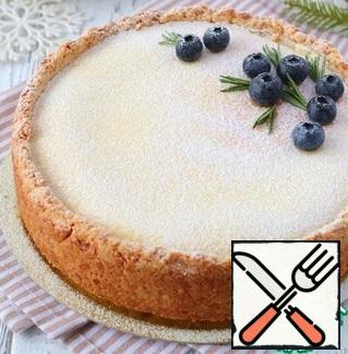 Next, put the form with the cheesecake in a cool place and let it cool completely, then remove the form. When serving, the cheesecake can be sprinkled with powdered sugar if desired and decorated with fresh blueberries.