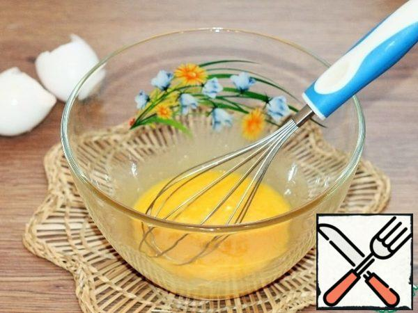 Separate the whites from the yolks. Beat the yolks with a whisk.