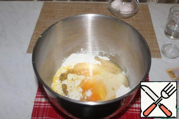 Add the eggs, zest of one lemon and vegetable oil.