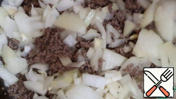 Add the onion, mix, and continue to cook for another 20-25 minutes (until tender)