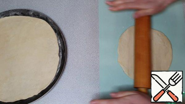 Cover the top with the second part of the dough