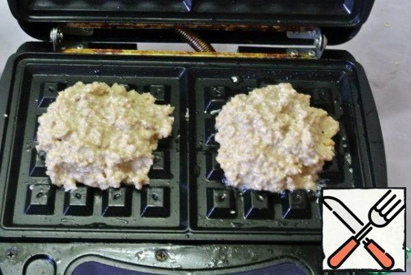 """Spread 1.5 tablespoons of dough on the panel of the multi-baker """"Viennese waffles""""."""
