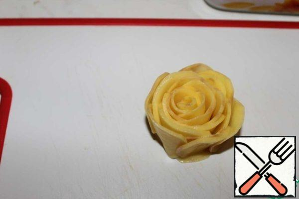 In a circle, add slices forming a rose.