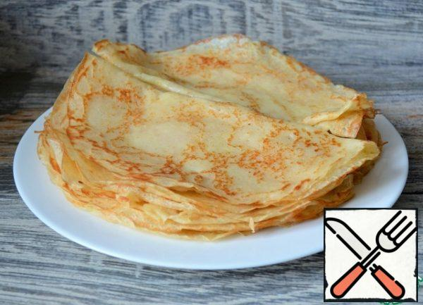 Bake unsweetened pancakes according to your favorite recipe. If you don't have any yet, there will be links at the end of the recipe.