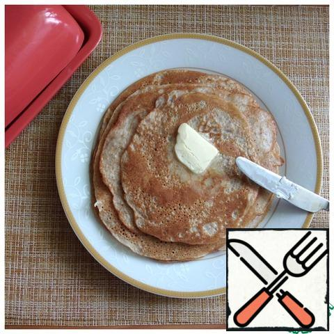 Removing each pancake from the pan, we lubricate its face generously with butter. From this amount of dough we get 6 pieces of pancakes D~20 cm. This is enough for 2 servings. Pancakes are very, very tasty, increase the ingredients by 2 times!