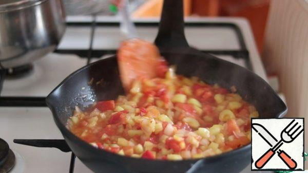 Add tomatoes and pepper. Simmer until soft. The sauce is ready.