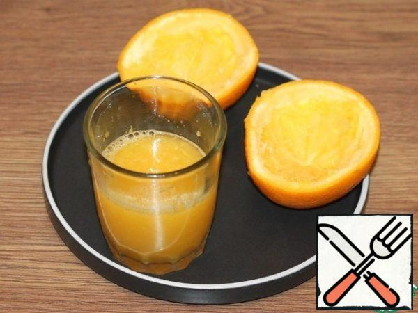 Squeeze the juice out of the orange.