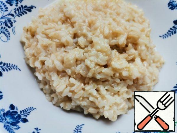 We boil the rice as indicated on the package. I added a little more water to achieve a slightly viscous consistency.