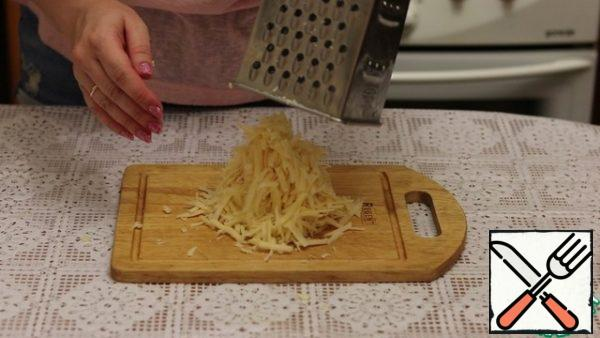 Grate the cheese on a medium grater.