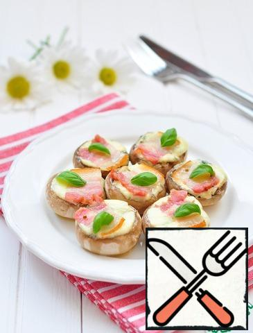 Drizzle well with olive oil, cover each mushroom with a slice of pancetta.Bake at 180* 15-17 minutes. When serving, sprinkle with fresh basil.