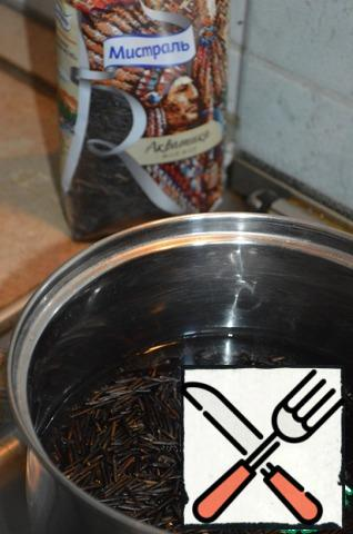 Prepare wild rice as indicated on the package.