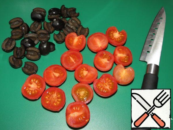 Cut the olives into slices, and the cherries in half.