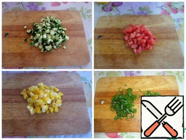 Cut the vegetables into cubes. Finely chop the greens.
