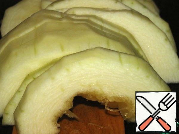 Peel and core the zucchini, cut into half rings, and add salt.