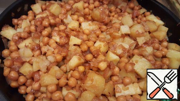Add the potatoes to the pan. Mix well. Cover and simmer for another 5-10 minutes.