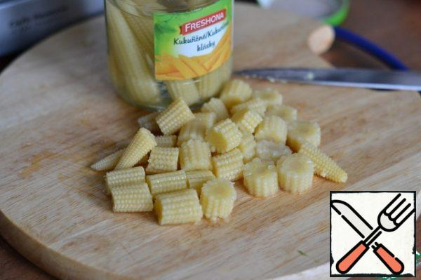 Mini corn cobs cut into three pieces.