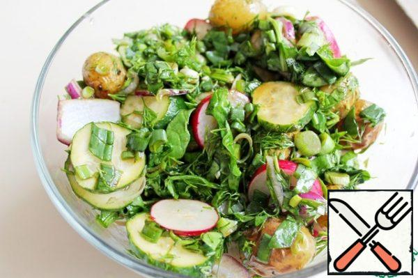 Combine all the vegetables and herbs, season with salad dressing, mix and serve immediately.