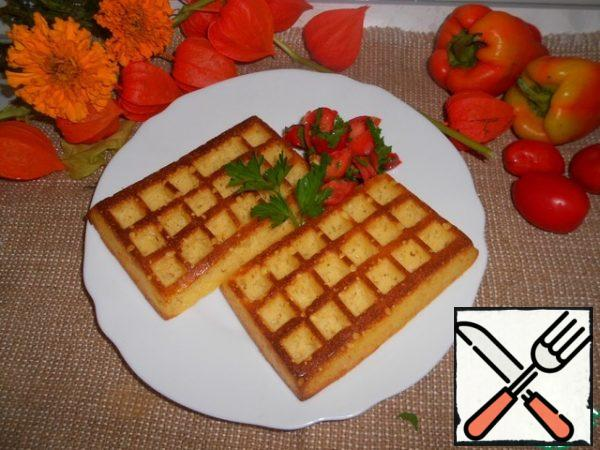 For the tomato salsa, cut the tomatoes and herbs, season with salt and pepper to taste, and pour over the lime juice. Serve the waffles with tomato salsa.