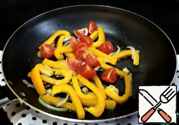 Next, add the cherry tomatoes, cut into 4 pieces, and fry for about two minutes.