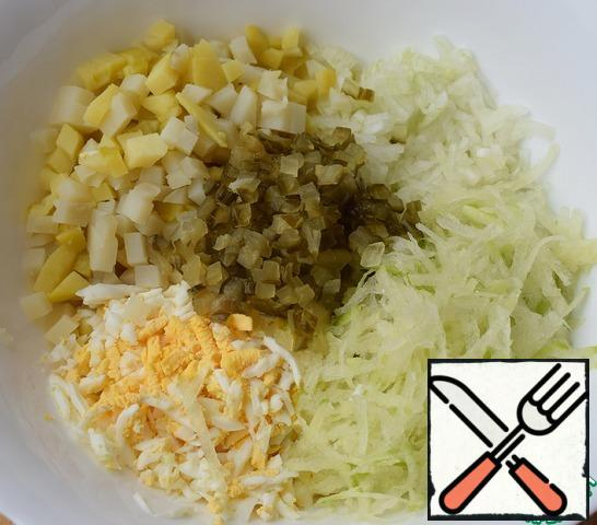 Cut potatoes, onions, and pickles. Add radish and eggs.