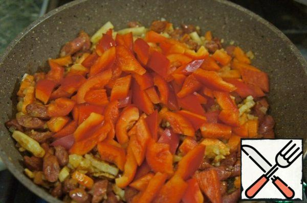 Next, add the garlic, onion, hot spices, whatever you want, paprika and pepper. Mix everything together.