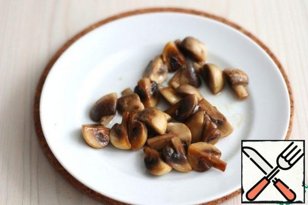 Put some of the mushrooms in a bowl.
