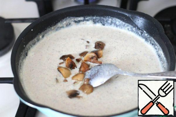 Next, add the pieces of fried mushrooms. Boil the sauce again over low heat. Then remove from heat.The sauce can be served with pasta, boiled rice, buckwheat porridge, French fries.