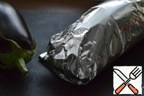 Wrap the eggplant in foil, each separately. Fold the foil in 2 layers so that it does not burn through.