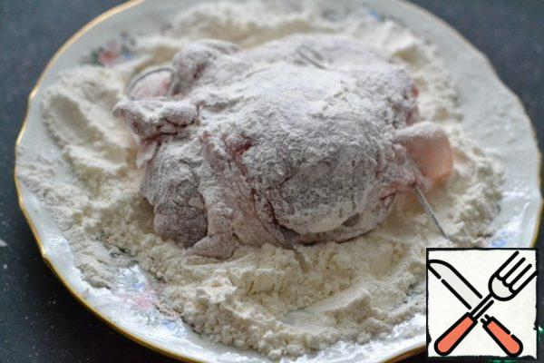 Roll the prepared meat in flour.