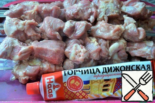Light the grill to gray coals. Thread the meat on skewers.