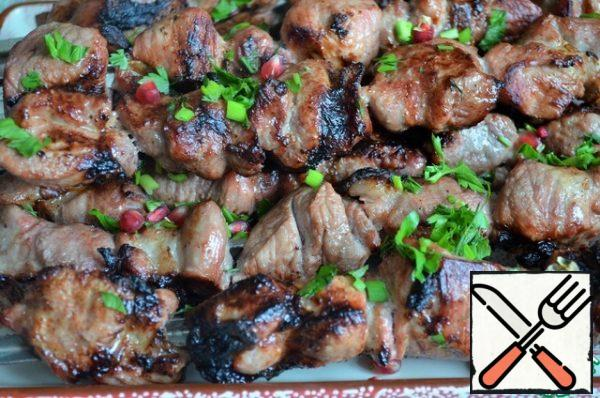 Fry until tender, 20-25 minutes, turning constantly. Serve the shish kebab hot, with herbs and pomegranate seeds.
