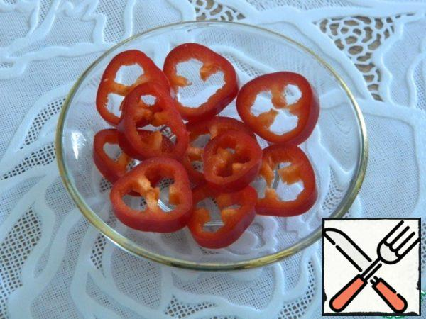 Hot pepper from the tip without seeds, thinly cut into circles.