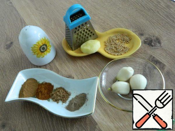 We will prepare the necessary products. Prepare spices, garlic, ginger, vinegar, oil, salt.