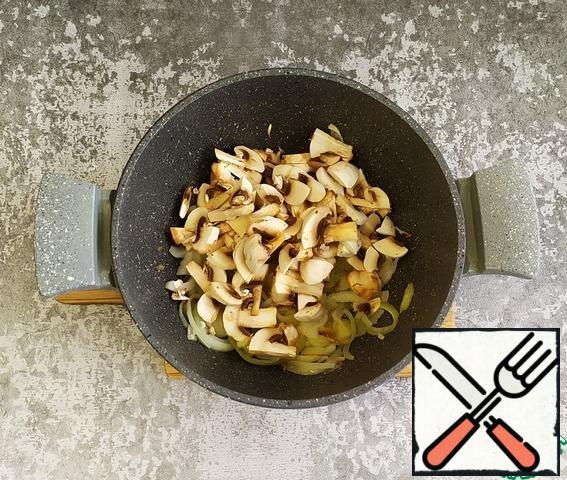 Add the chopped mushrooms. Lightly fry.