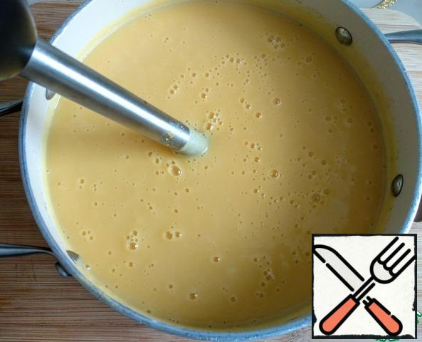 Then puree with a blender until smooth. Bring to a boil, cover and remove from heat.