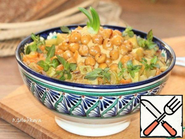 We put the chickpea mass in the bowl (middle) and the zucchini with vegetables around the edges. Sprinkle the chickpea spread with fried sesame seeds, and the vegetables with small basil leaves.