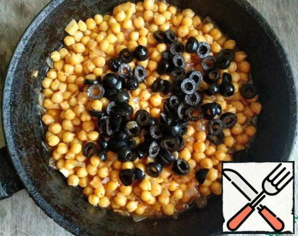 Then add the chopped olives and simmer for another 3-5 minutes.