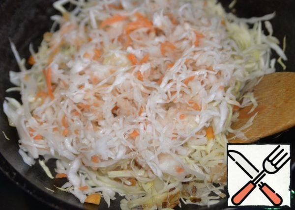 Add the sauerkraut, stir, and simmer over medium heat for 10 minutes.