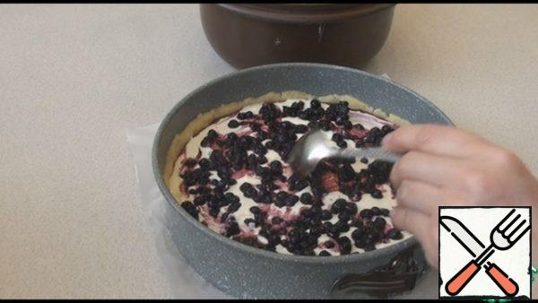 Bake the cheesecake in a preheated 180 degree oven for 55 minutes.