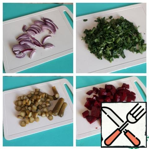 Beets cut into cubes, onions-straws, cucumbers cut into rings, fresh parsley chop.