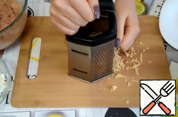 Grate the cheese on a coarse grater.