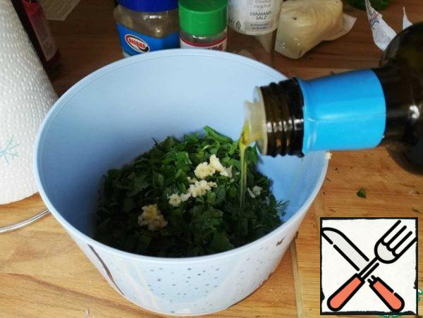 Finely chop the herbs and garlic, mix with salt, pepper, lemon juice. Add a little oil and stir
