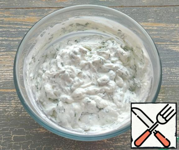 Mash the cheese with a fork, add kefir and finely chopped dill.